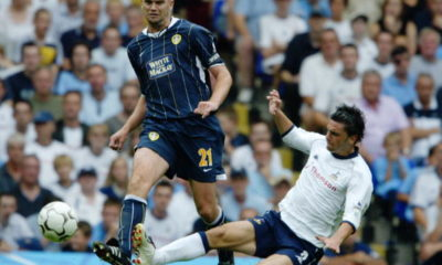 Dominic Matteo of Leeds United and Helder Postiga of Tottenham Hotspur