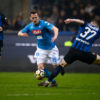 Arkadiusz Milik (C) of SSC Napoli competes for the ball with