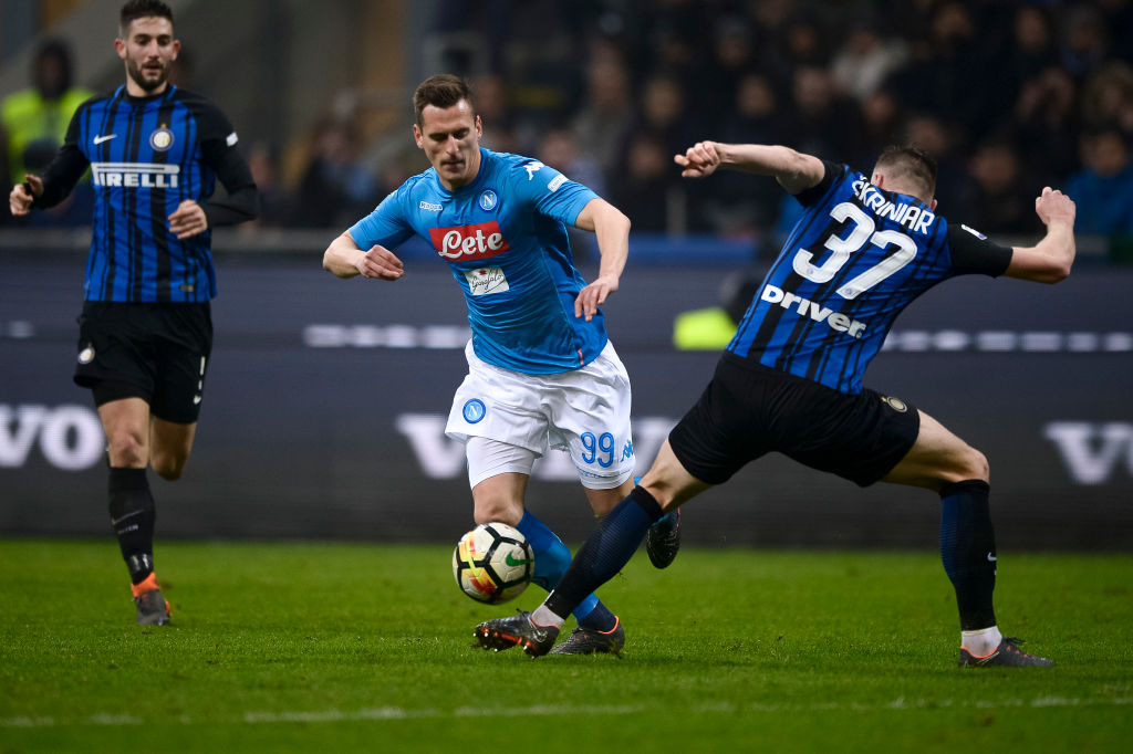 Arkadiusz Milik (C) of SSC Napoli competes for the ball with...