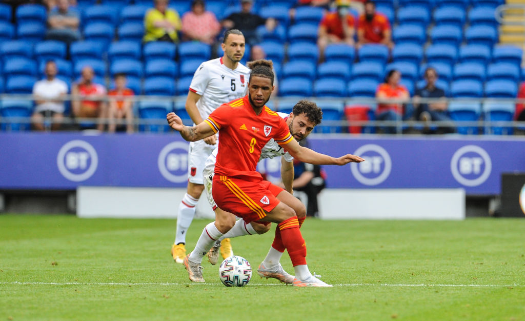 Leeds United star Tyler Roberts in action on international duty with Wales
