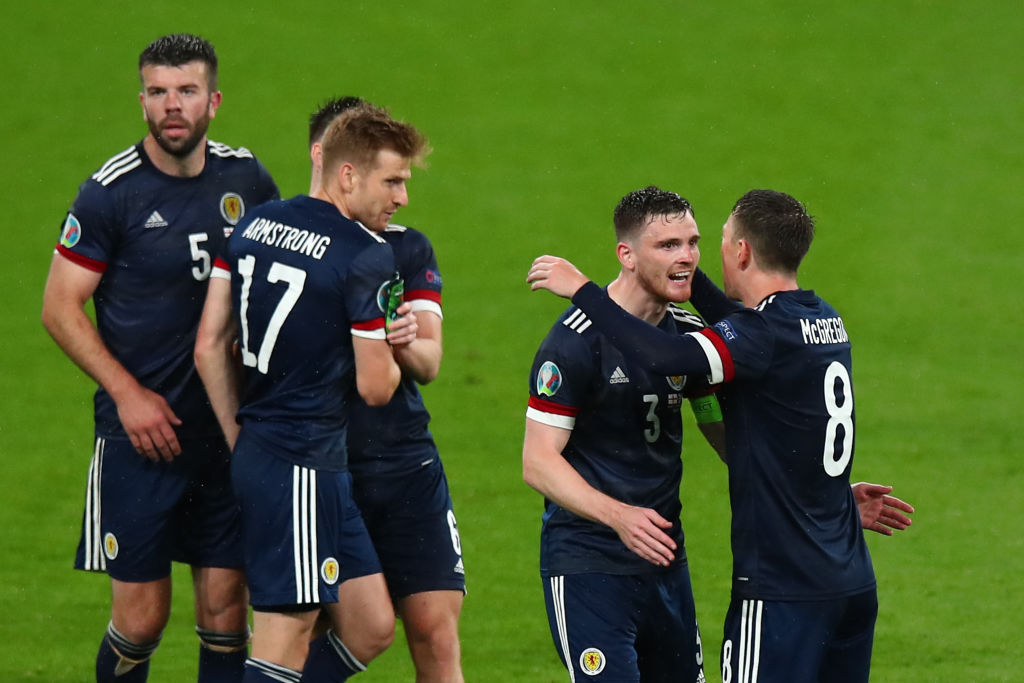 England v Scotland: Scotland players embrace after the Euro 2020 draw at Wembley
