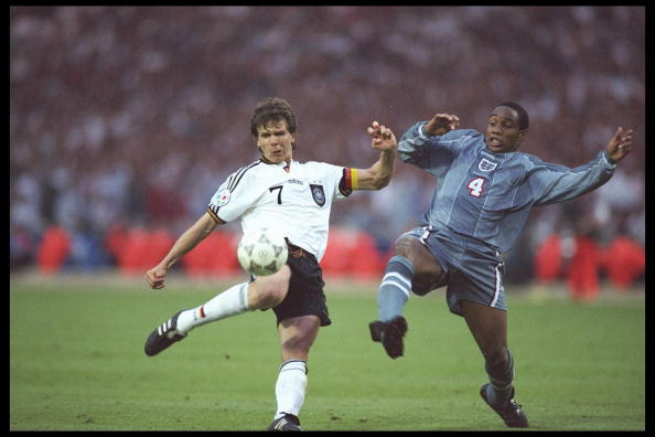 Andreas Moller of Germany left is challenged with Paul Ince of Engalnd