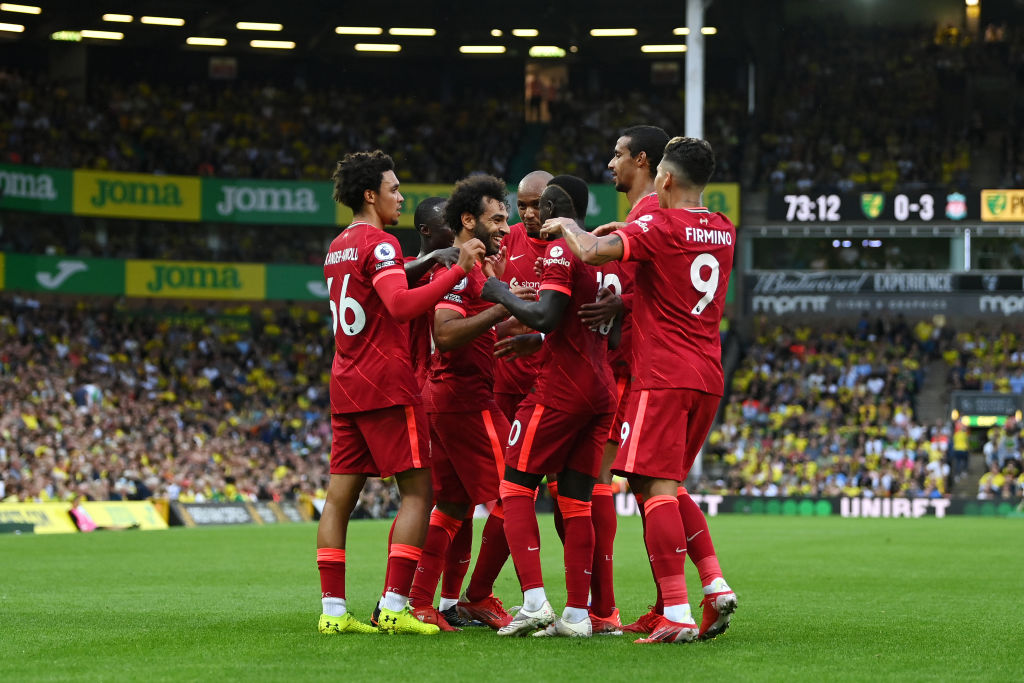 Liverpool celebrate after their third goal against Norwich