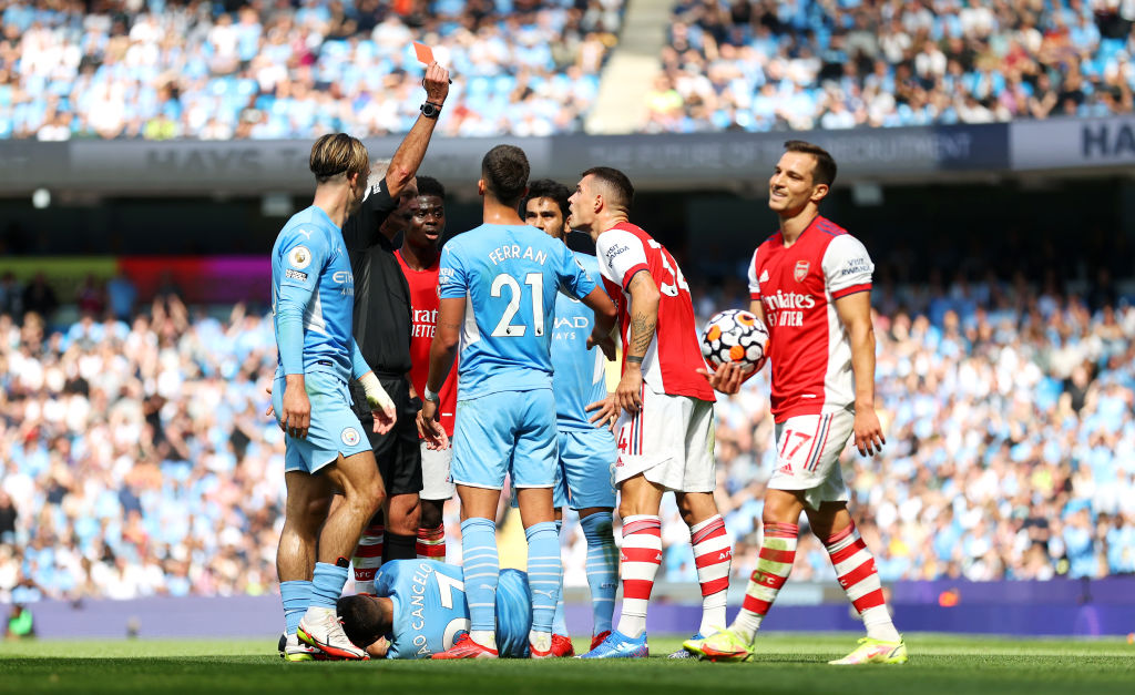 Granit Xhaka is shown a red card as Arsenal lost to Manchester City